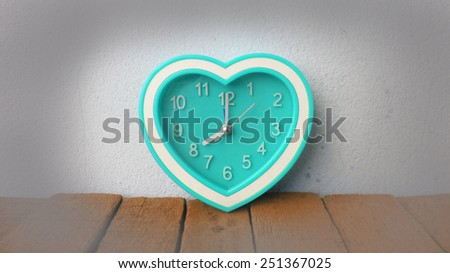 vintage back with retro alarm clock on table black and white - stock photo