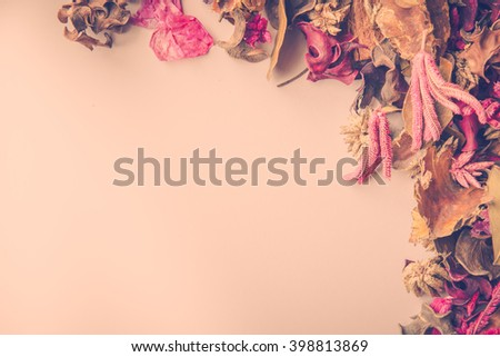 Vintage backdrop image with dried flower potpourri and room for copy. - stock photo