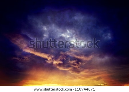 Vintage background of dramatically illuminated stormy clouds
