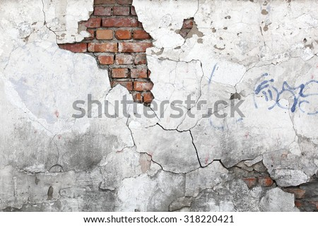 vintage background texture old masonry stone bricks on the ancient cement with cracks - stock photo
