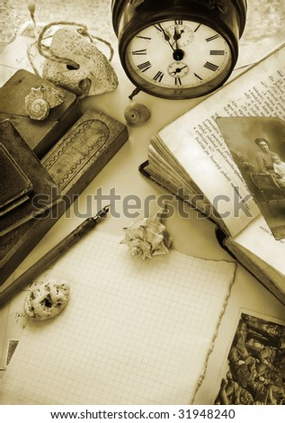 Vintage background with alarm clock in sepia tone - stock photo