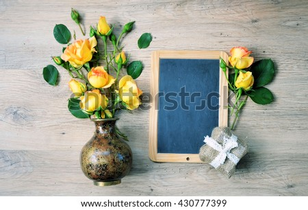 Vintage background with chalkboard  and flowers for congratulations and invitations ,colorful lifestyle - stock photo