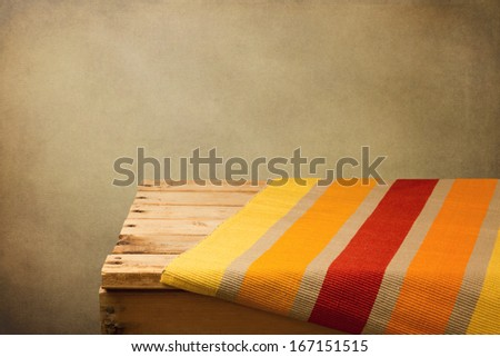 Vintage background with empty wooden table and place mat - stock photo