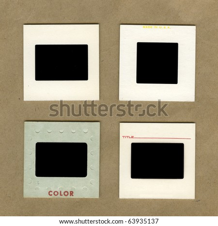 vintage background with four types of slide photography mounts - stock photo
