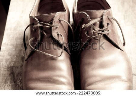 Vintage background with men's shoes - stock photo