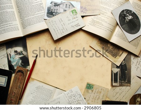 Vintage background with old books, postcards and photographs - stock photo