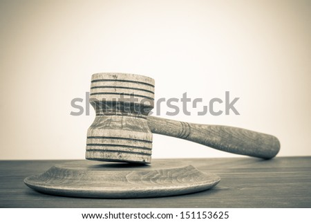 Vintage background with old judge gavel on wooden table - stock photo