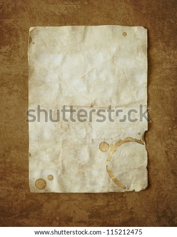 Vintage background with old paper and coffee stain - stock photo