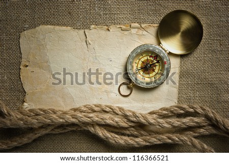 Vintage background with old paper and compass - stock photo