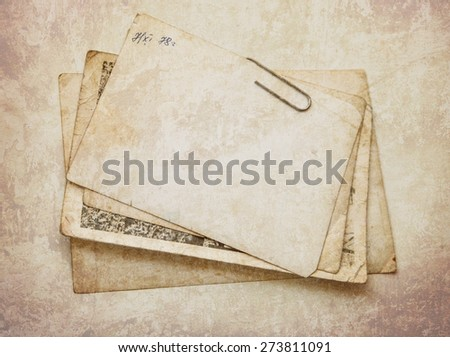 Vintage background with old paper and letters - stock photo