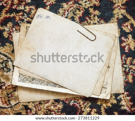 Vintage background with old paper and letters on cloth - stock photo