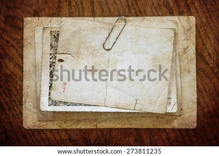 Vintage background with old paper and letters on wood - stock photo