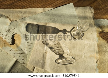 Vintage background with old paper, letters and two liqueur glasses - stock photo