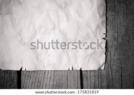 Vintage background with old paper on wooden background