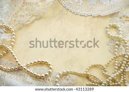 Vintage background with pearls and old doilies - stock photo