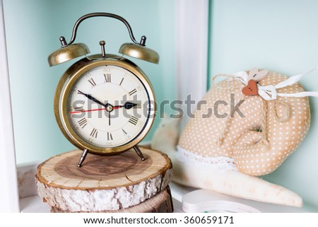 Vintage background with retro alarm clock on a shelf