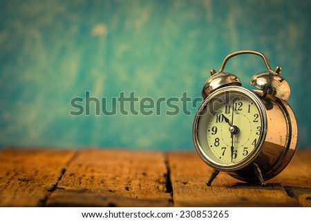Vintage background with retro alarm clock on table. black and white - stock photo