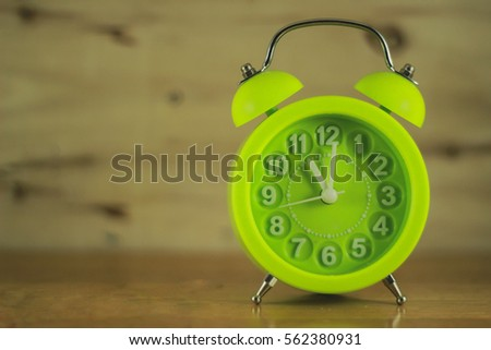 Vintage Background With Retro Alarm Clock On Table.selective Focus