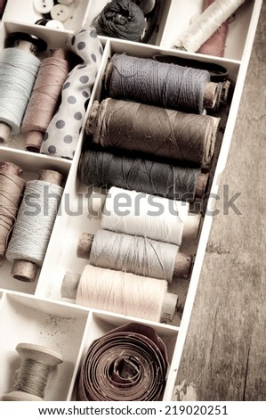 Vintage Background with sewing/Sewing kit.Bobbins with thread and needles - stock photo