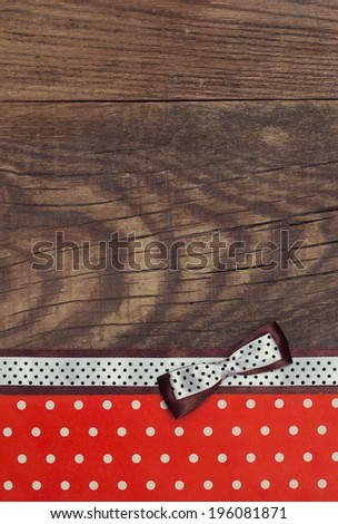 vintage background with wood, polka dot paper and brown and white polka dot ribbon with bow - stock photo
