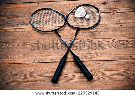Vintage badminto racquets with shuttlecock - stock photo