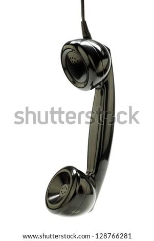 vintage bakelite telephone horn hanging on a white background - stock photo