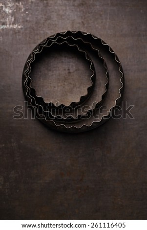 Vintage  Baking Tin cutters on metal backdrop, shallow dof - stock photo