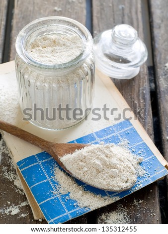 Vintage bank with whole wheat flour, selective focus - stock photo