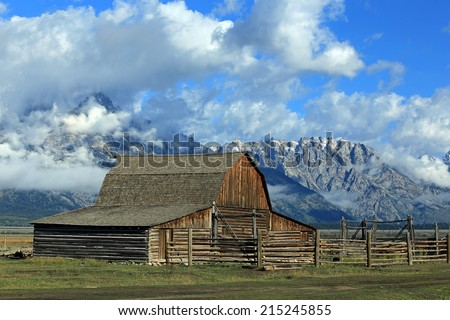 Vintage barn with the Teton's in the background, Wyoming, USA. - stock photo