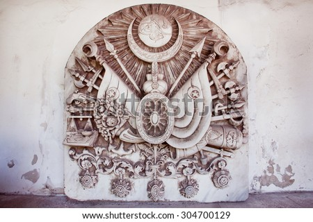 Vintage bas-relief with Coat of arms of the Ottoman Empire. Final design of royal dynasty symbol was adopted by Sultan Abdul Hamid II on 1882.  - stock photo