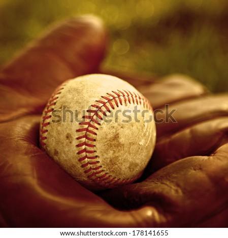 Vintage baseball glove and ball - stock photo