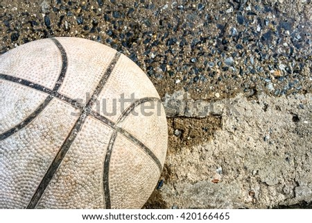 Vintage basketball on a concrete floor background in the spotlight