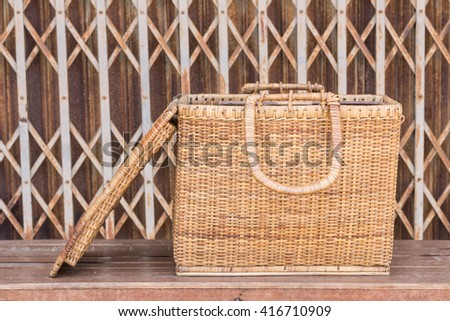 Vintage baskets.- Antique wicker basket made from a craft. Manufactured using handmade. Antique wicker baskets with steel door stretch background.  - stock photo