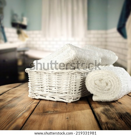vintage bathroom interior and white towels on retro table top  - stock photo