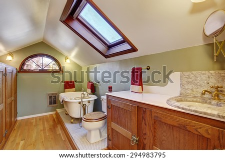 Vintage bathroom with marble sink, and vaulted ceiling. - stock photo