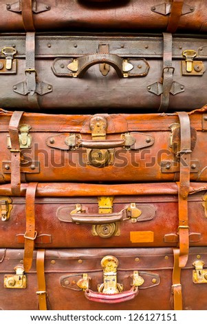 Vintage battered brown bags stacked vertically - stock photo