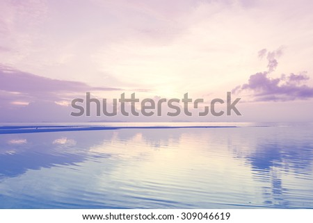 Vintage beach and sky at dusk - stock photo