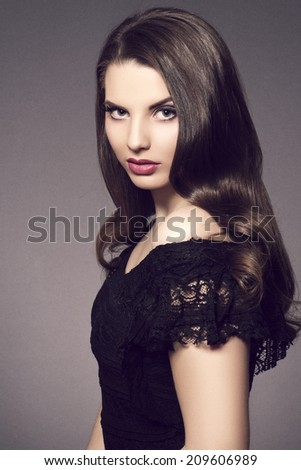 Vintage beauty portrait of fashion model girl with long wavy hair