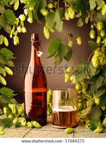 Vintage beer with hops - stock photo