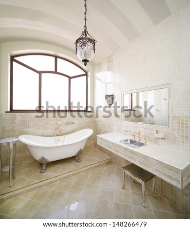 Vintage beige color bathroom with a golden sanitary engineering  - stock photo