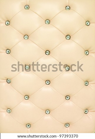 Vintage beige leather background with crystal button - stock photo