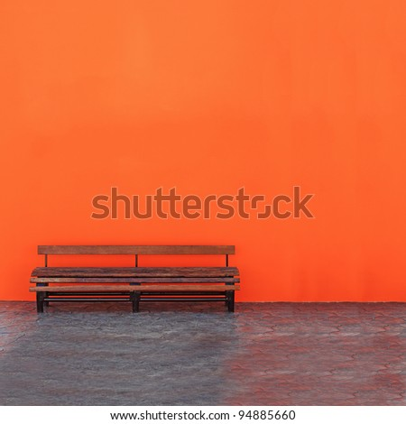 Vintage Bench Against blank Wall - stock photo