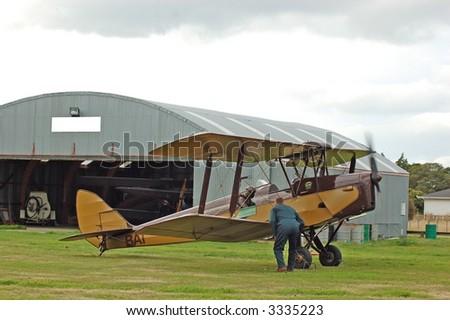 vintage Bi-plane-last minute checks prior to take-off - stock photo
