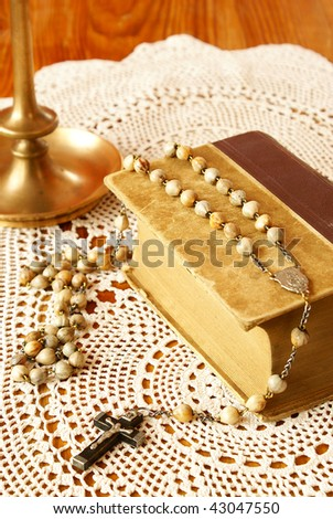 Vintage Bible, rosary beads and candle holder