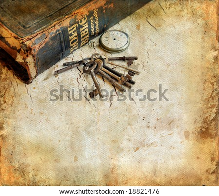 Vintage Bible with pocket-watch and keys on a grunge background with room for your own text.