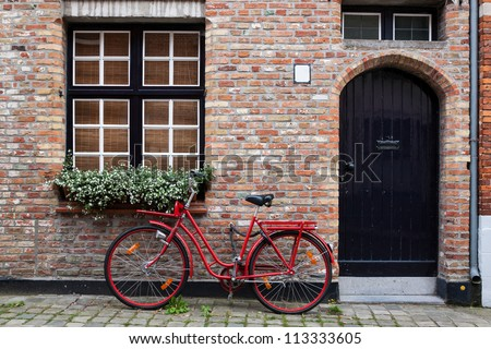 Vintage Bicycle Against House Wall - stock photo