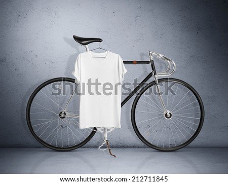 Vintage bicycle and white t-shirt - stock photo