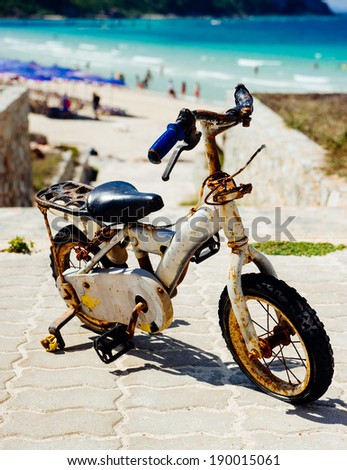 vintage bicycle at the beach - stock photo