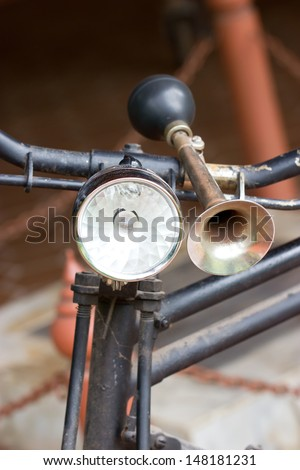Vintage bicycle horn on handlebar. - stock photo