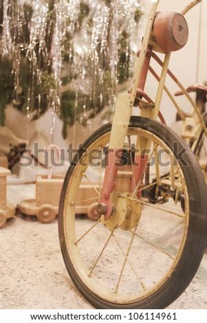 Vintage bicycle near Christmas tree. Nostalgic vintage image - stock photo